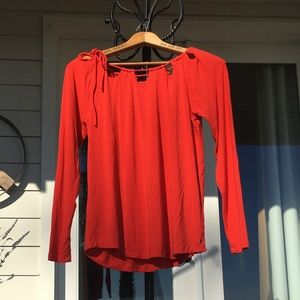 Shoulder feature bright red top by Fabletics
